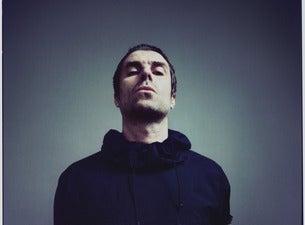 Liam Gallagher photo with dark background wearing a black sweatshirt